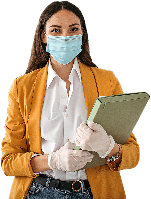 Businesswoman wearing a face mask and gloves to prevent COVID-19