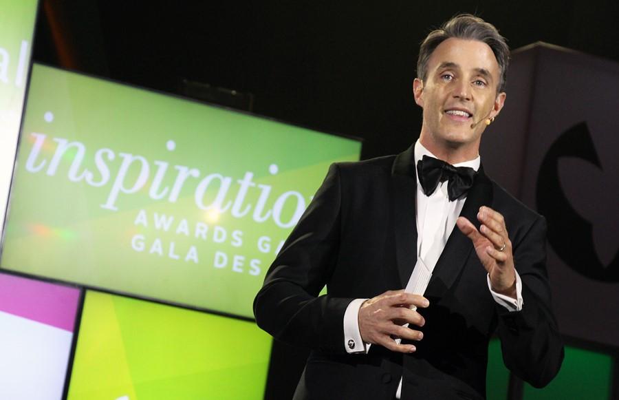An award host presenting.