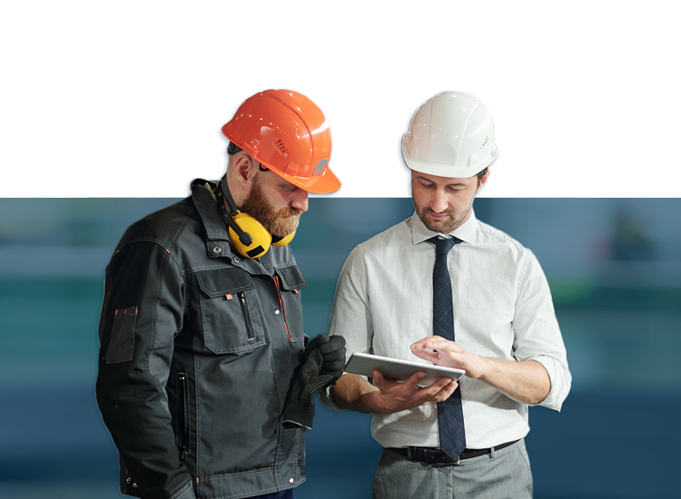 Manufacturing Banner: two workers talking in a industrial shed.