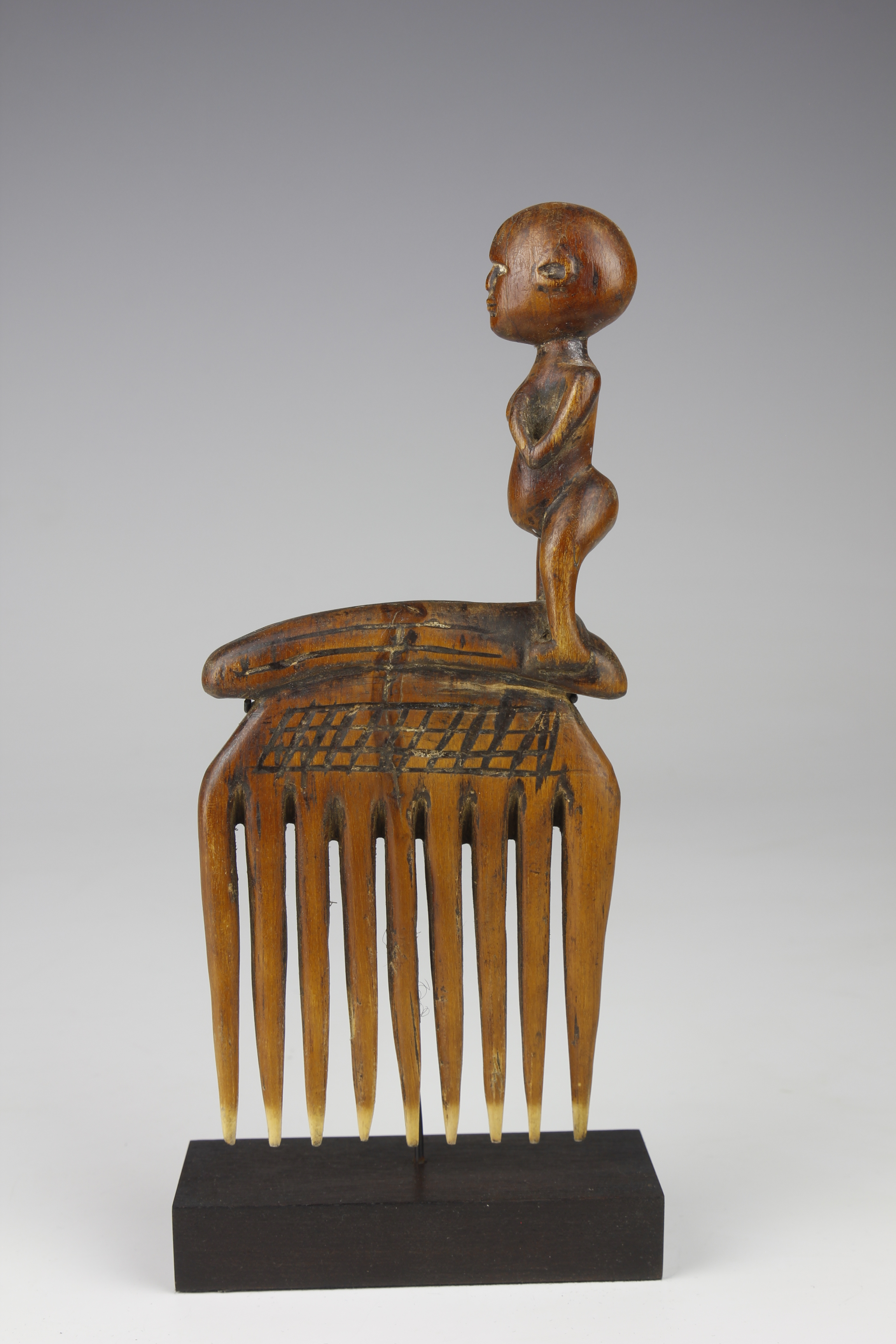 Comb with Standing Figure