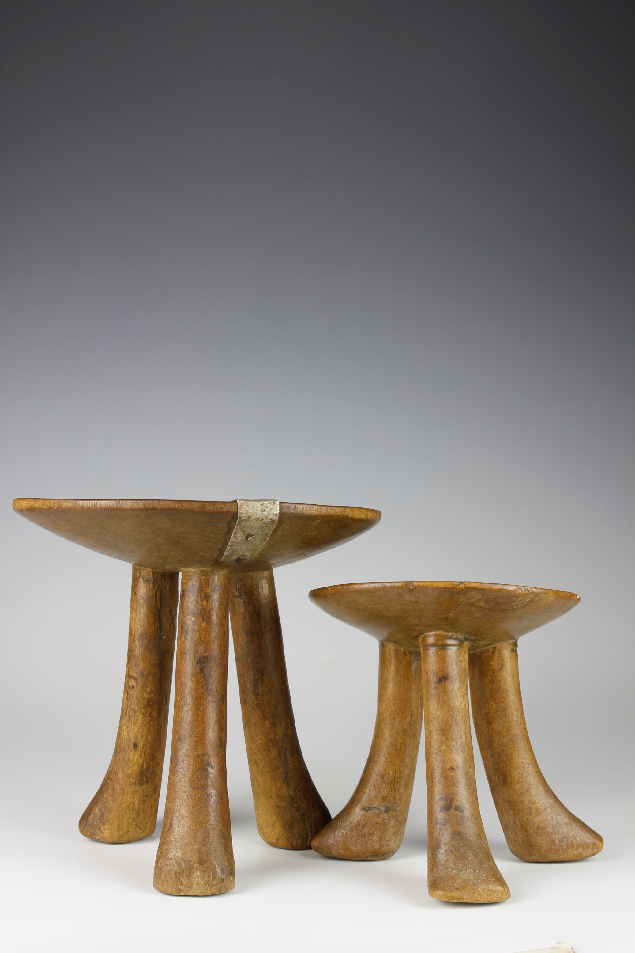 TWO SMALL ELDERS STOOLS