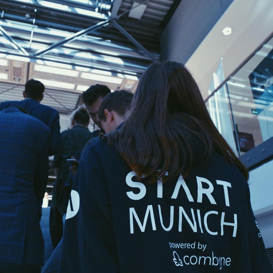 START Munich members on staircase