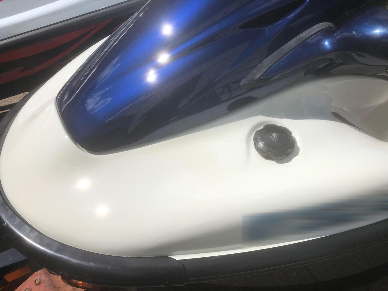 White and metallic blue jet ski.