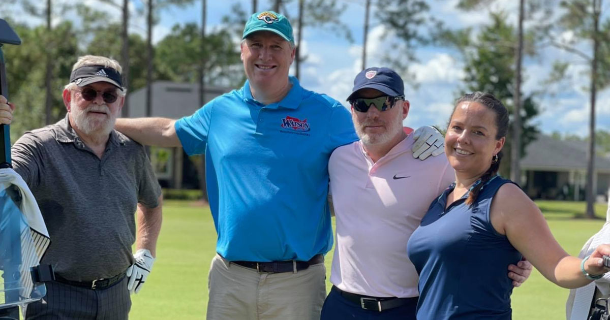 Foursome playing golf at Pars Fore Paws event