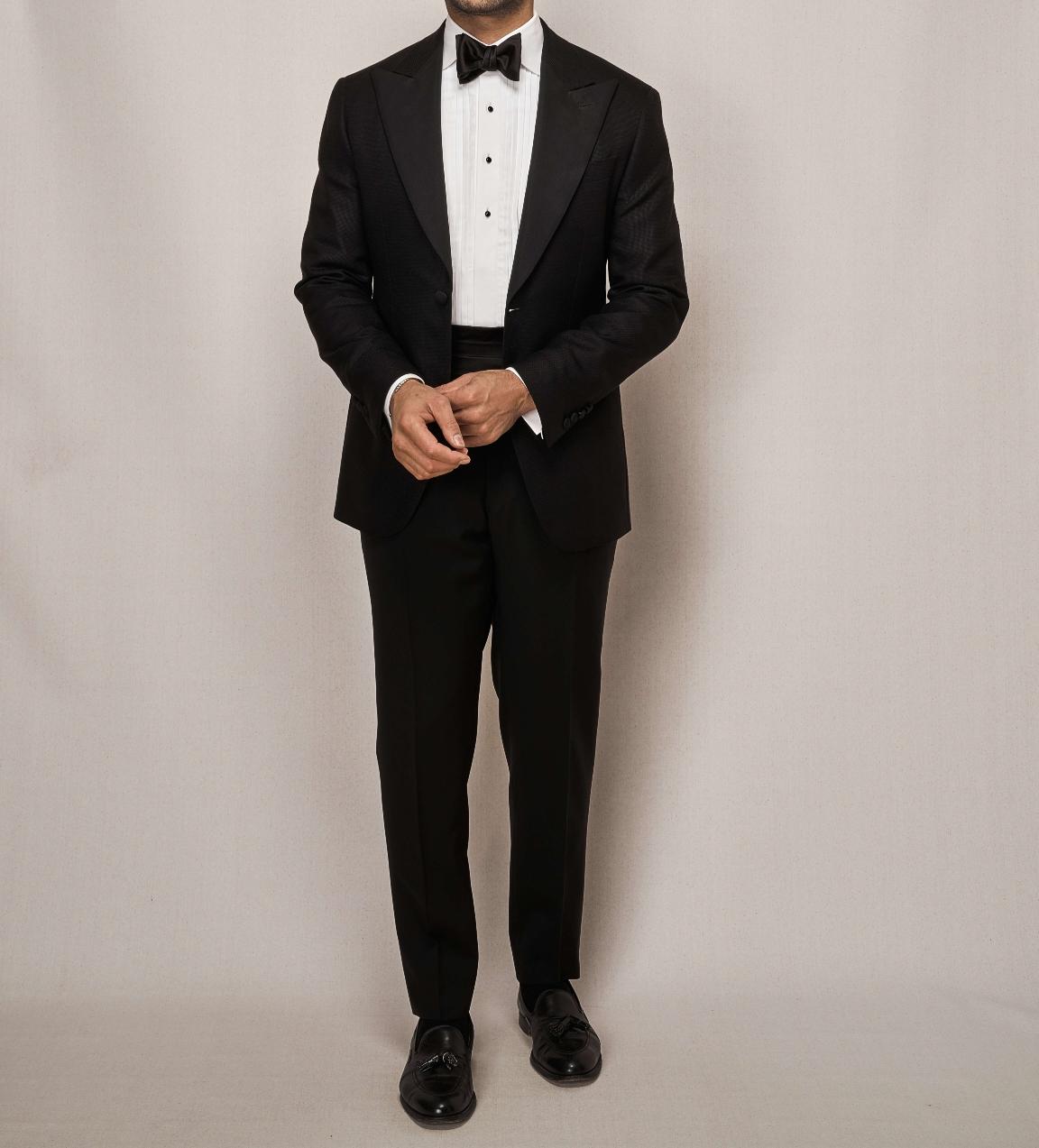 Man modelling classic tailor made black tuxedo