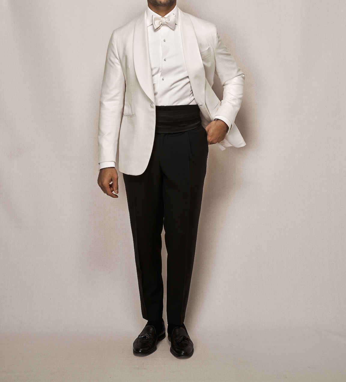 Man modelling classic all white tailor made tuxedo
