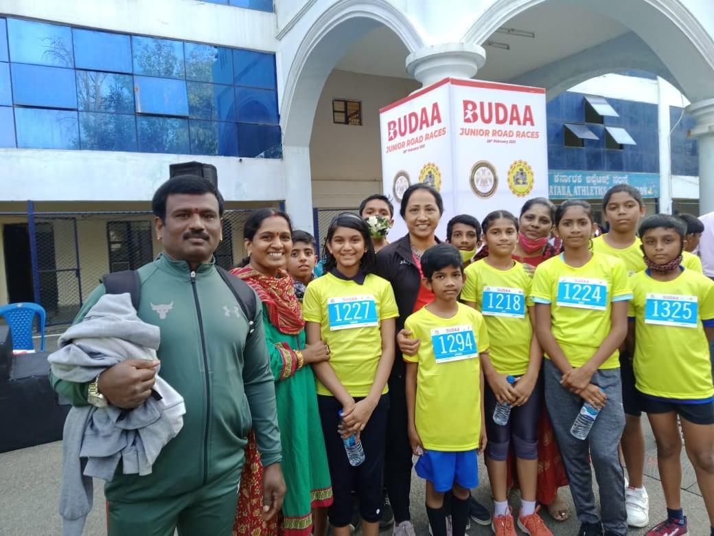 Students with former track and field athlete Ashwini Nachappa