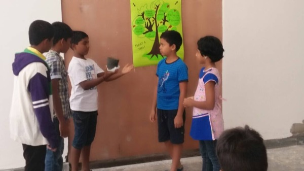 Students enacting a farmer's day play.