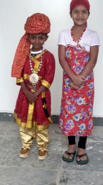 Two students dressed in traditional clothes.