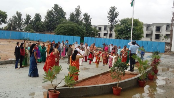 Attendees saluting the national flag.