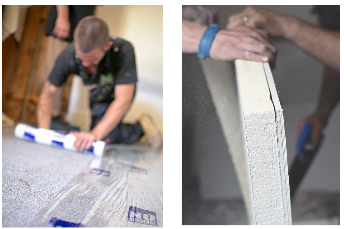Insulated plaster board being fitted