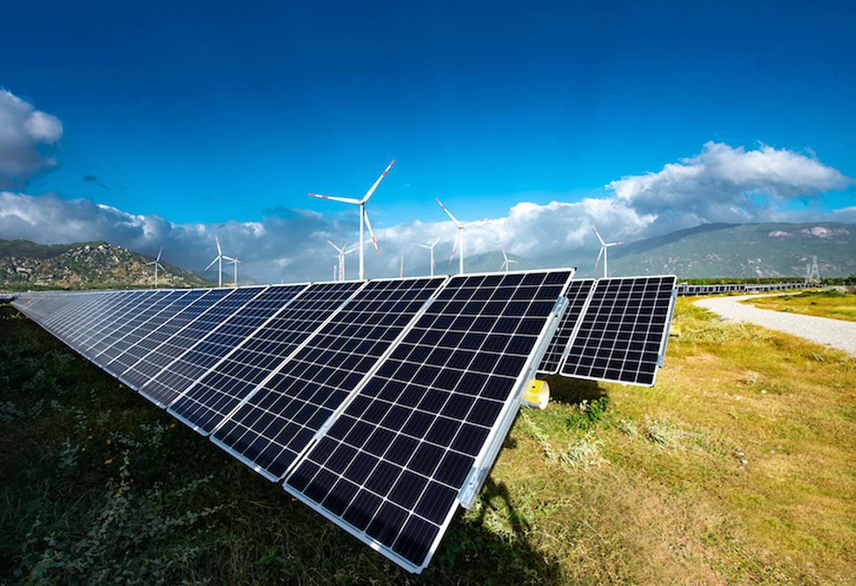 A solar farm with wind turbines
