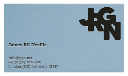 A sky blue business card with a minimal, modern design, featuring a sans serif stacked monogram 'JRGN' and tasteful slab-serif information - name, email, phone number, and cities. The business card is in a landscape orientation.