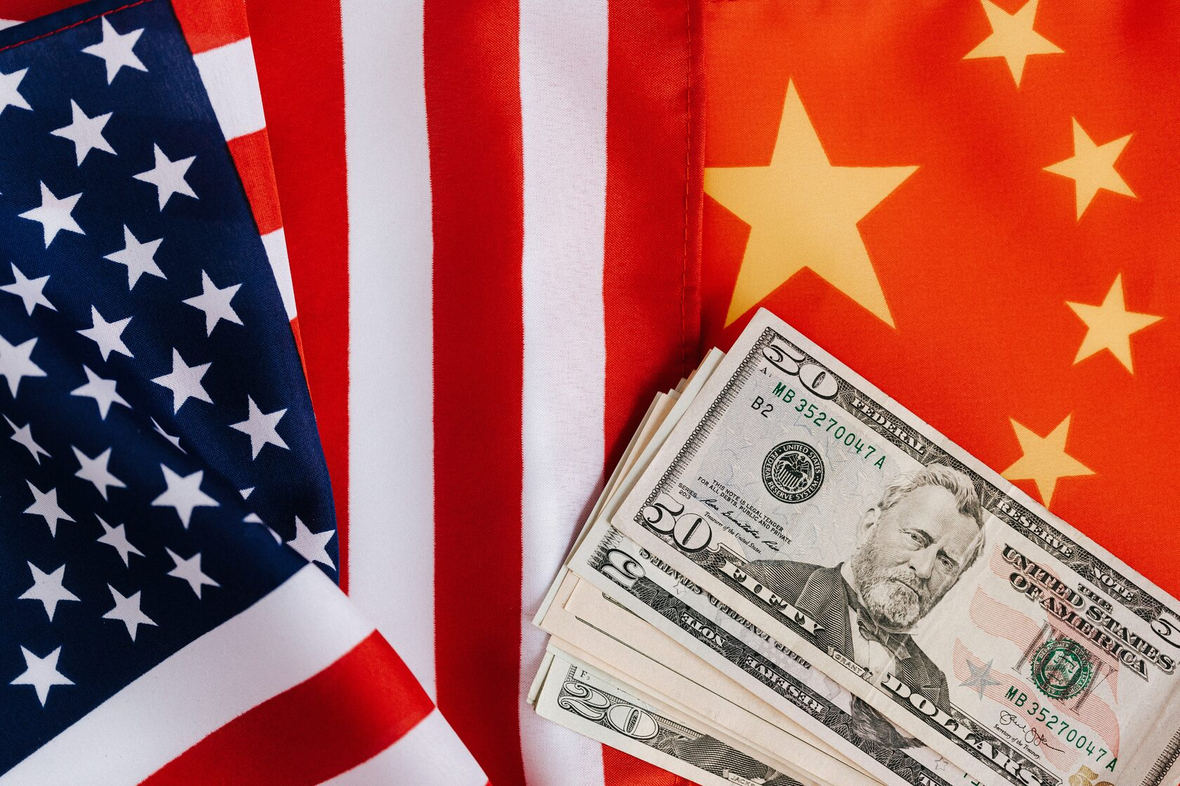 US and China flags with currency