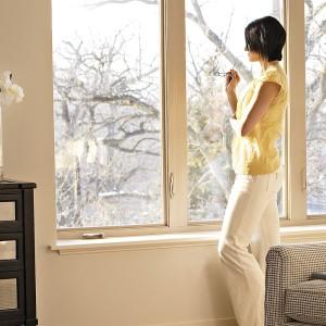 woman looking at new windows