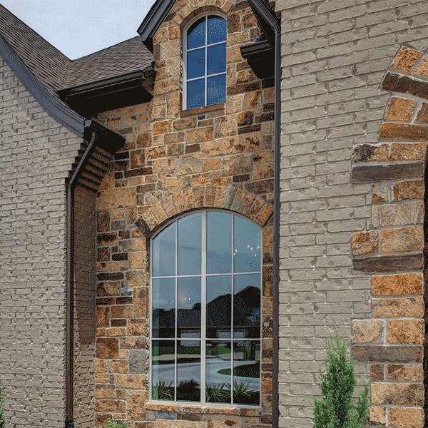 style line windows with grid on brick house