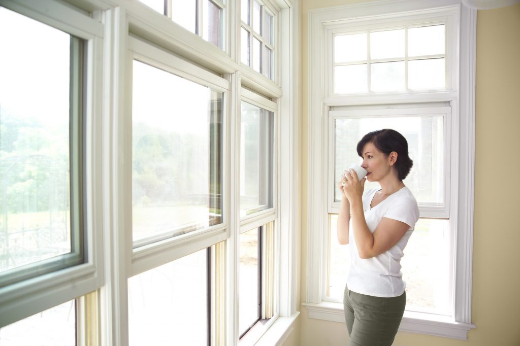 woman with new single hung windows