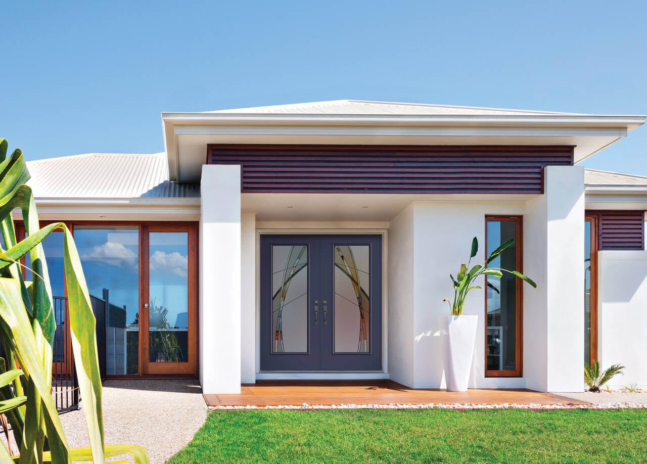exterior double door with design on glass