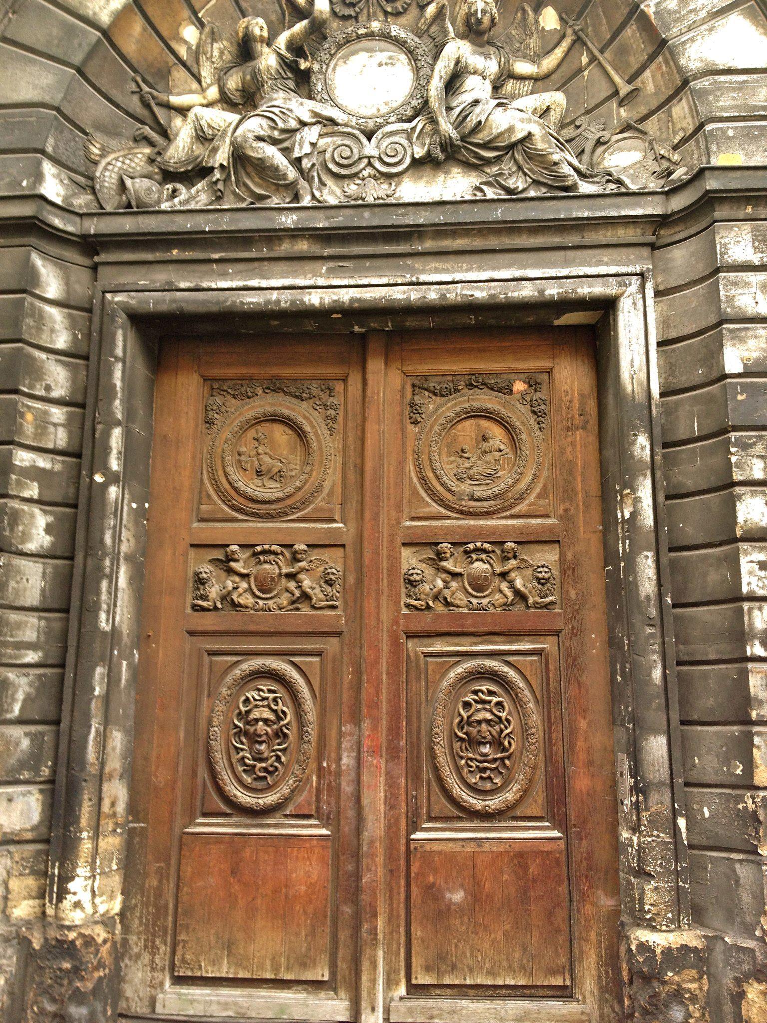 door showing Janus god of doors