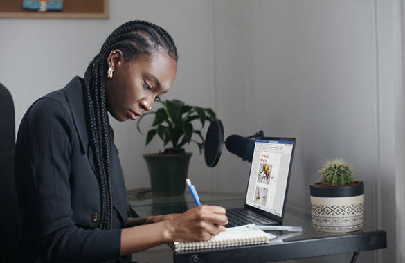Professional woman at computer - Photo by Unsplash