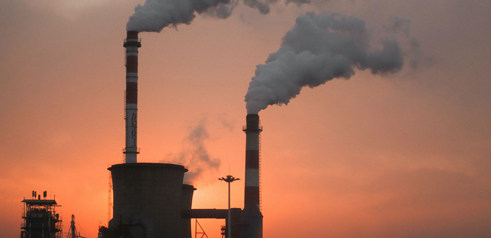 Pollution smoke coming out of factory chimneys.