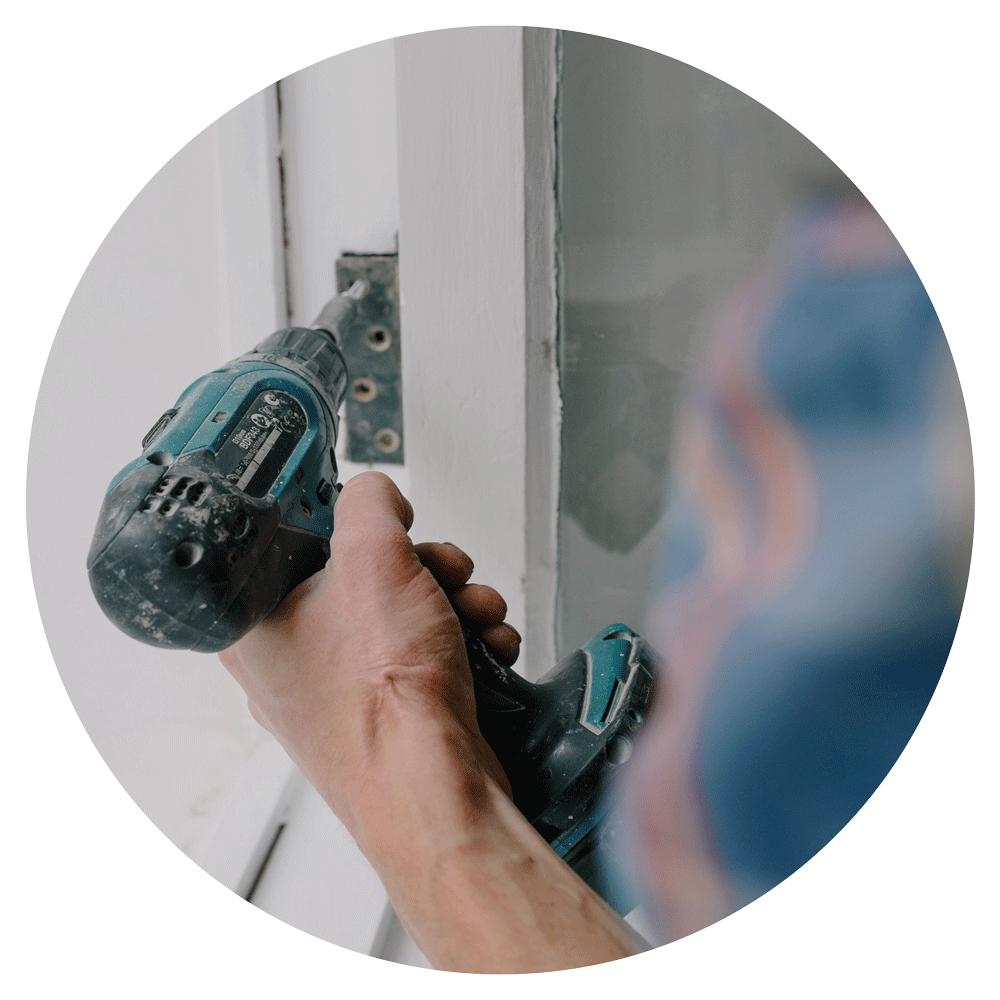 A builder attaching a door