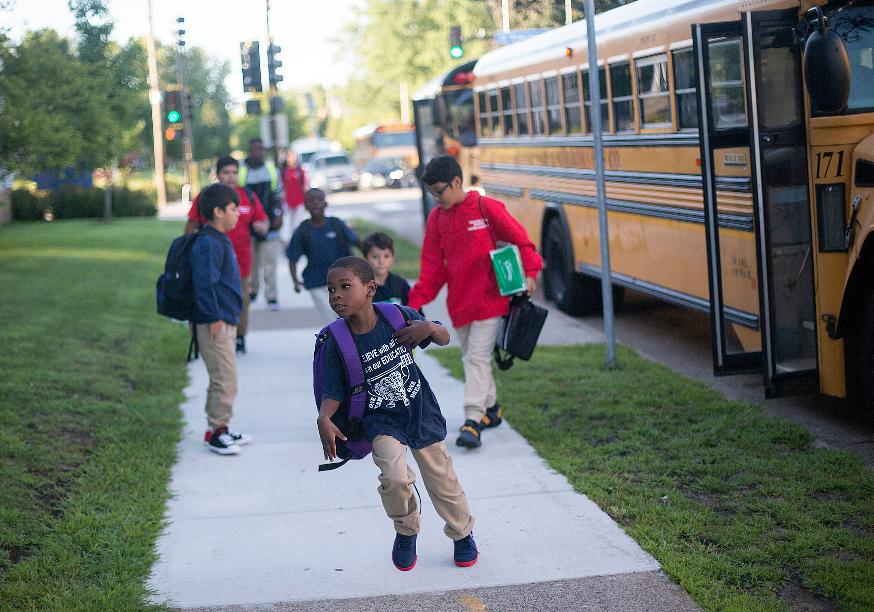 Child with backpack who just got off the bus