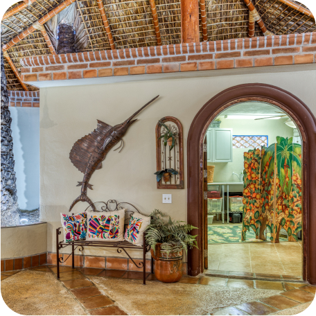 warm inviting home interior with palapa ceiling and attractive brick border
