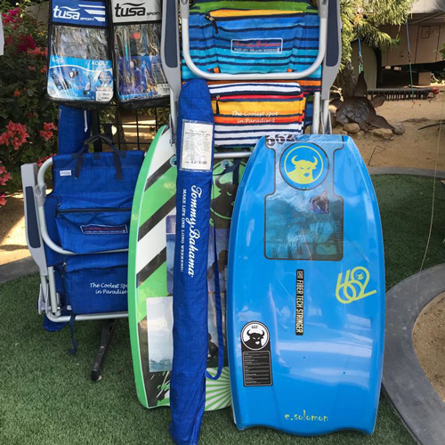 boogie boards in green and blue sitting on green grass