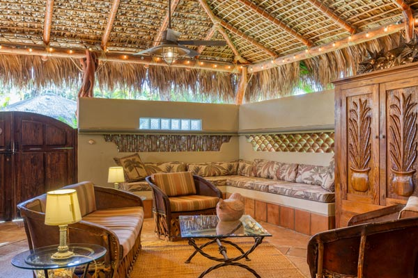casa viento opening living room with natural wood and palapa ceiling