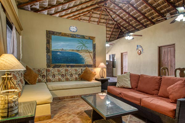 casa dorado living room with palapa ceiling and seaside mural on wall