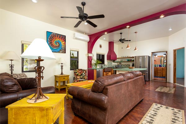 funky traditional Mexican living room with brown couch and high ceilings