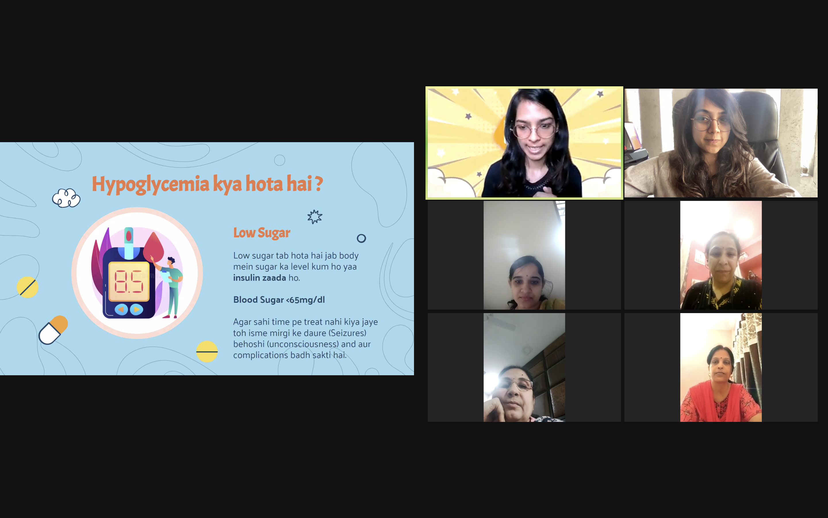 Screenshot taken of a workshop on zoom where 6 people's faces are showing on camera, all looking at a blue slide with information about hypoglycaemia.