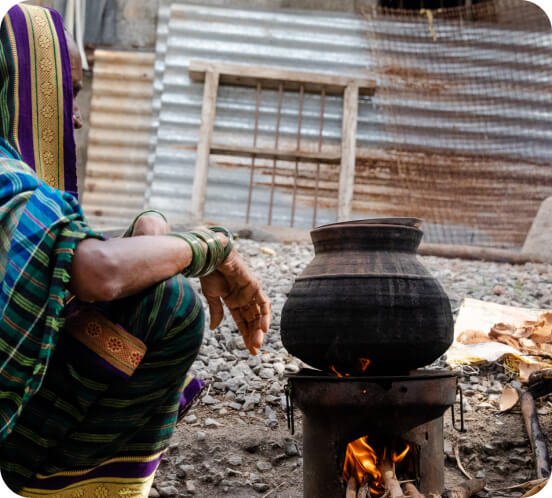 Project picture; woman cooking on open fire
