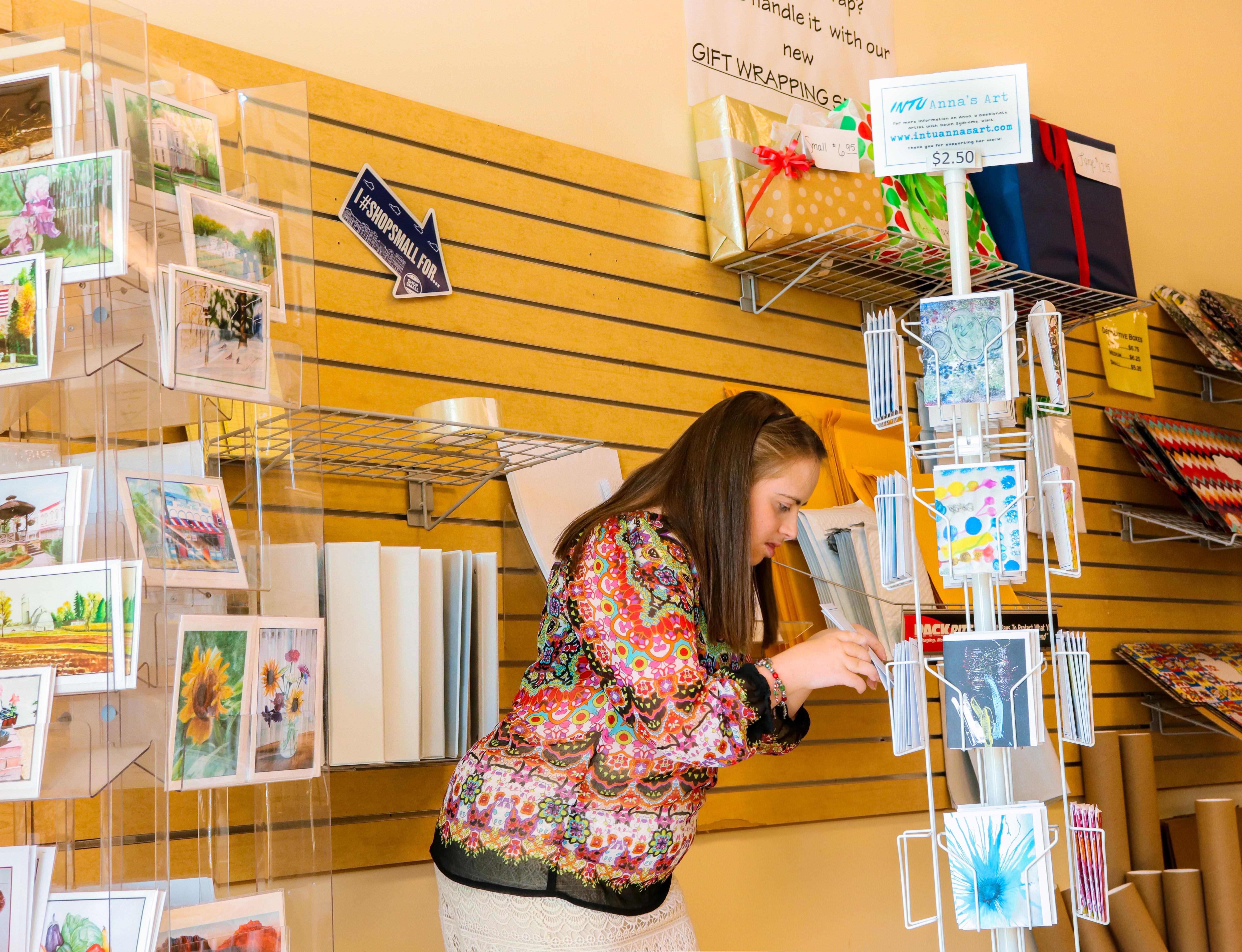 Anne Restocking cards At drugmart