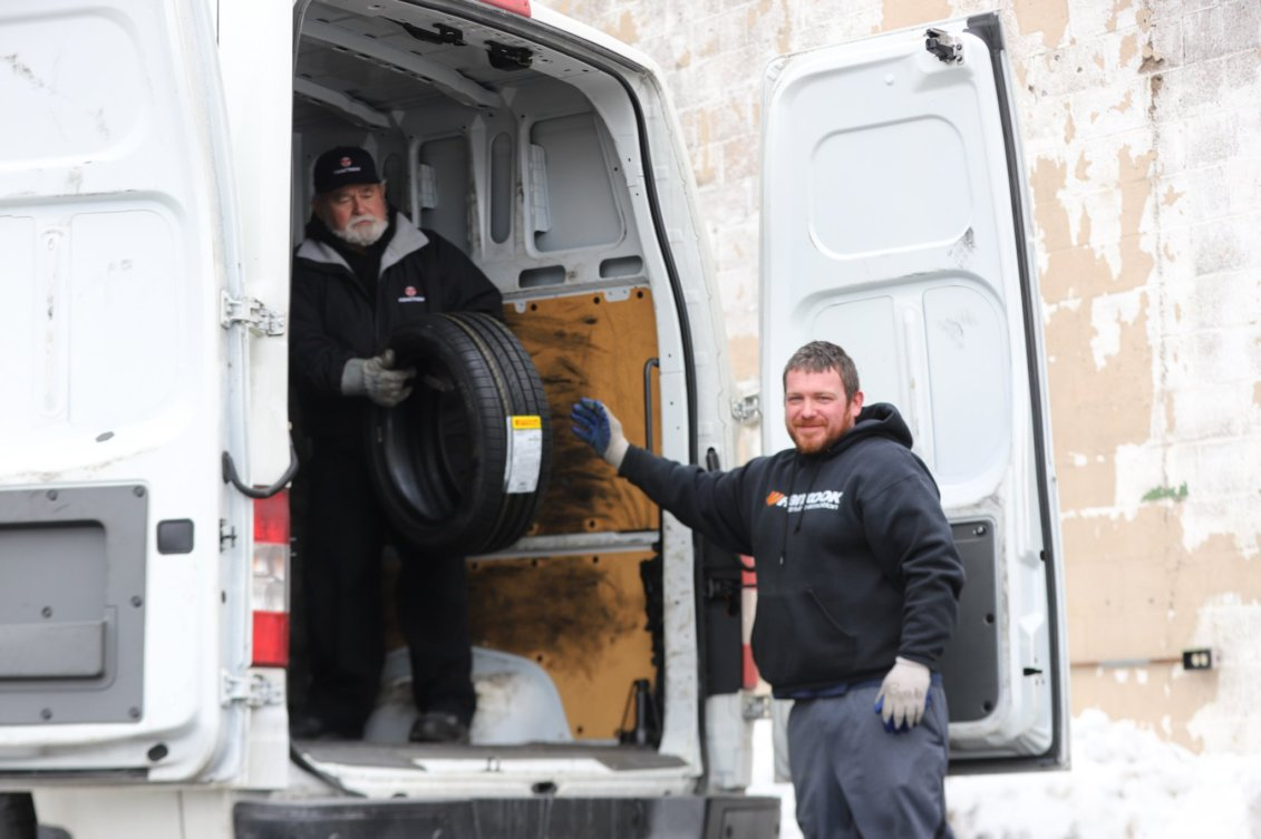 two employees loading truck
