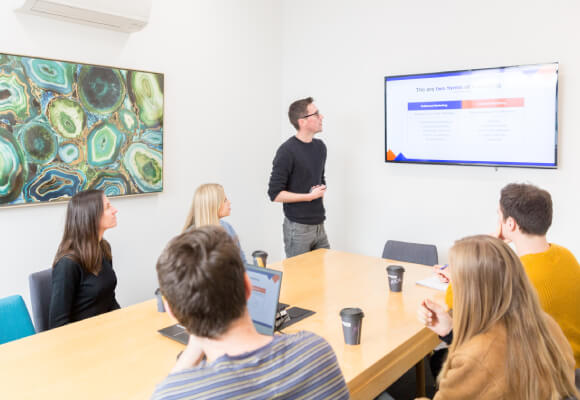 A group of digital marketers having a meeting in a board room