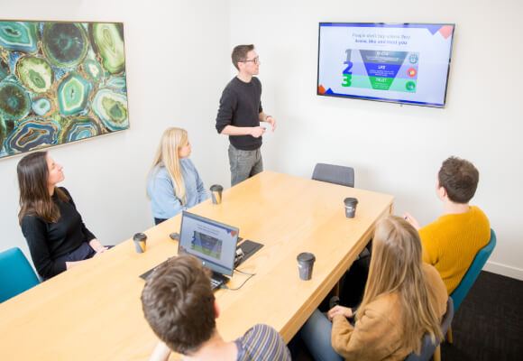 A team of digital marketers have a meeting