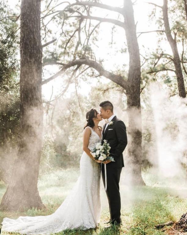 Man and woman taking wedding shot