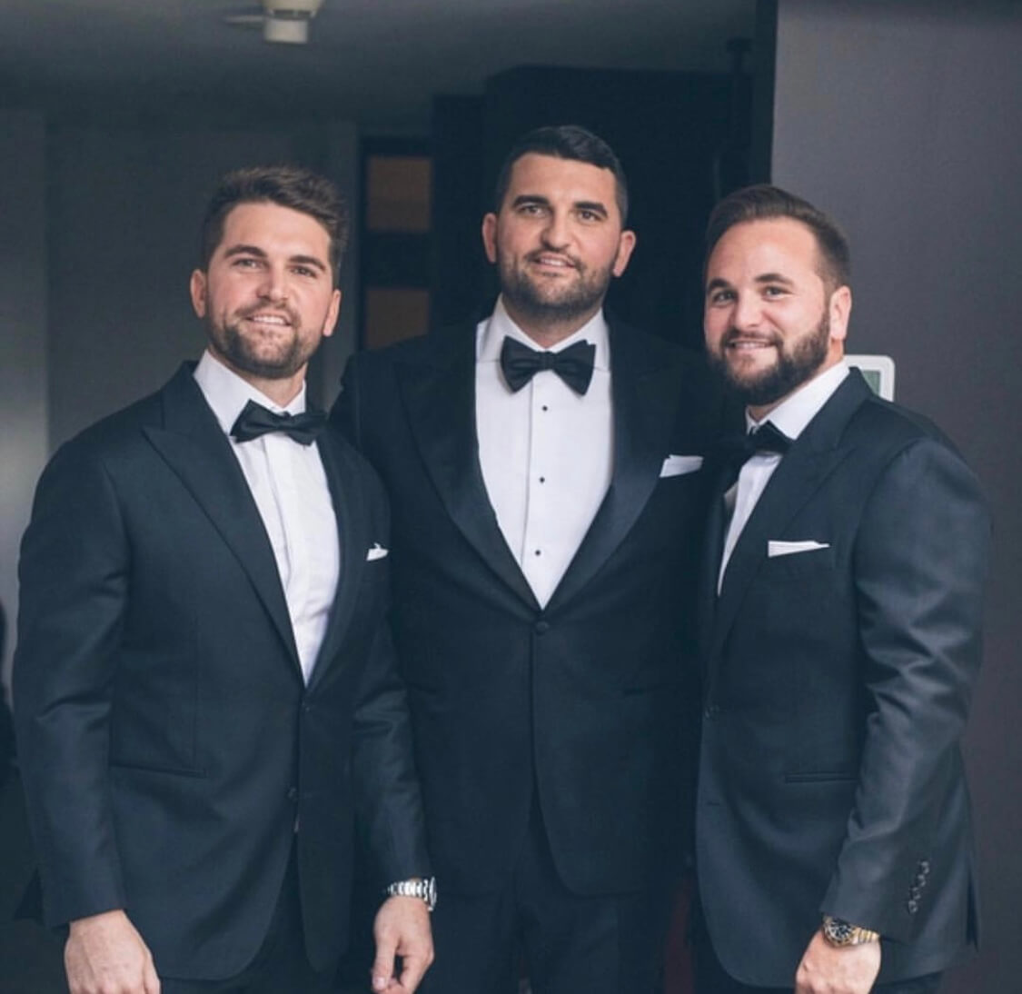 Men wearing a tailor made wedding suits 2