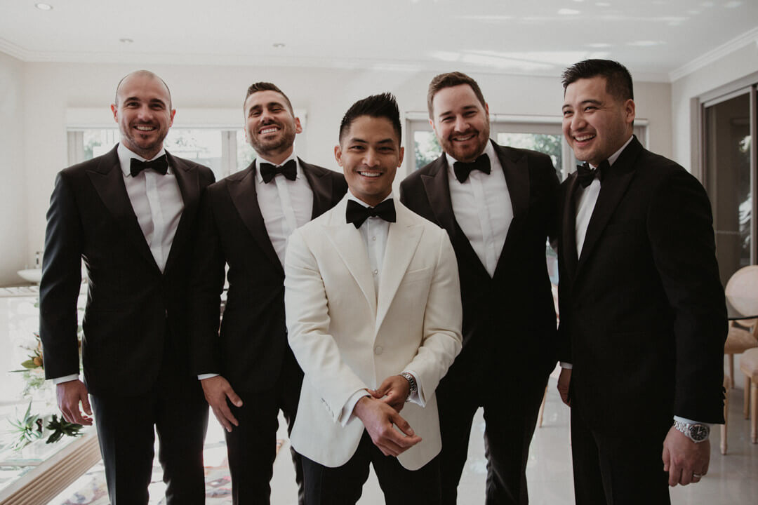 Men wearing a tailor made wedding suits 4