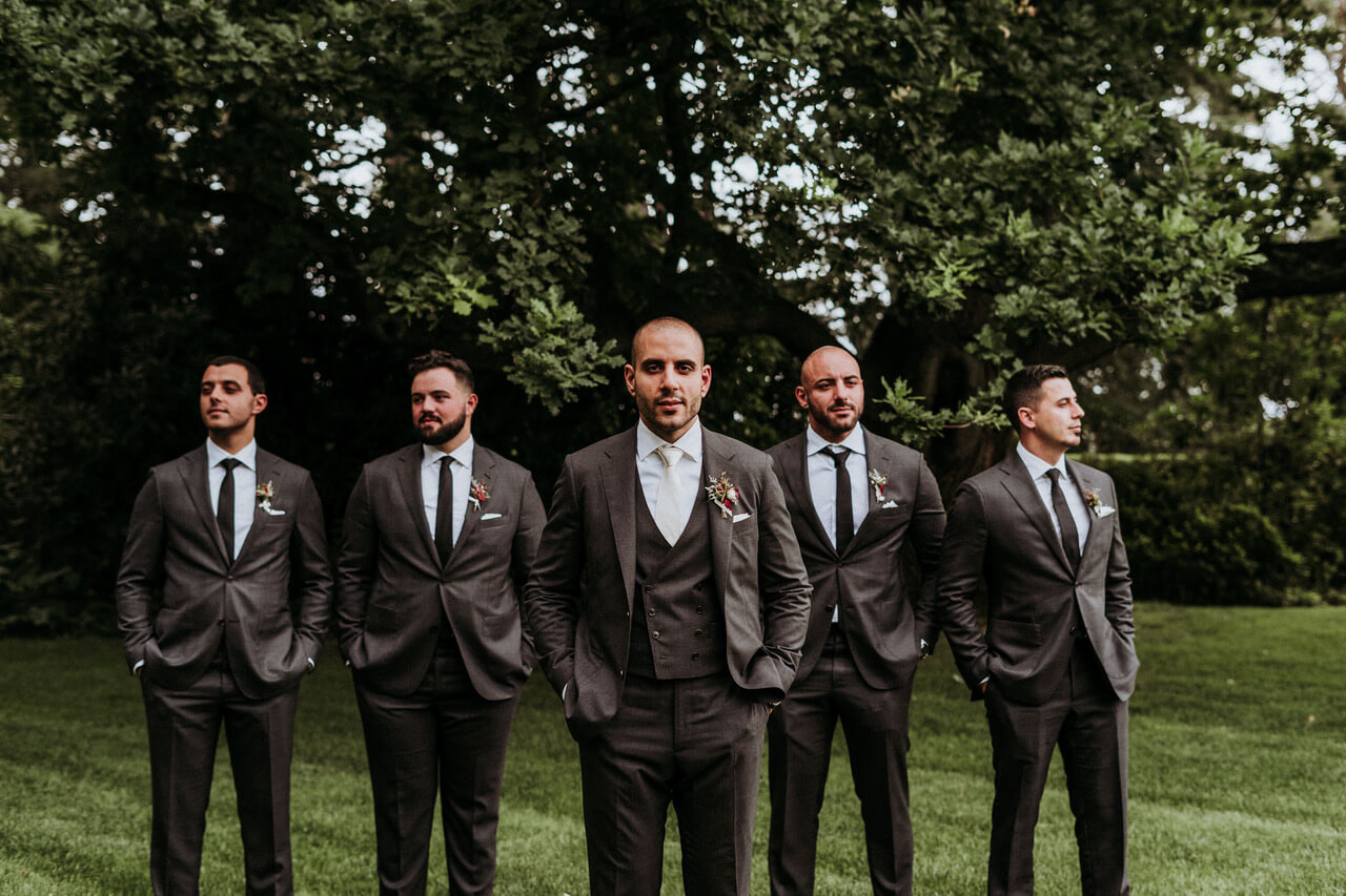 Men wearing a tailor made wedding suits 6