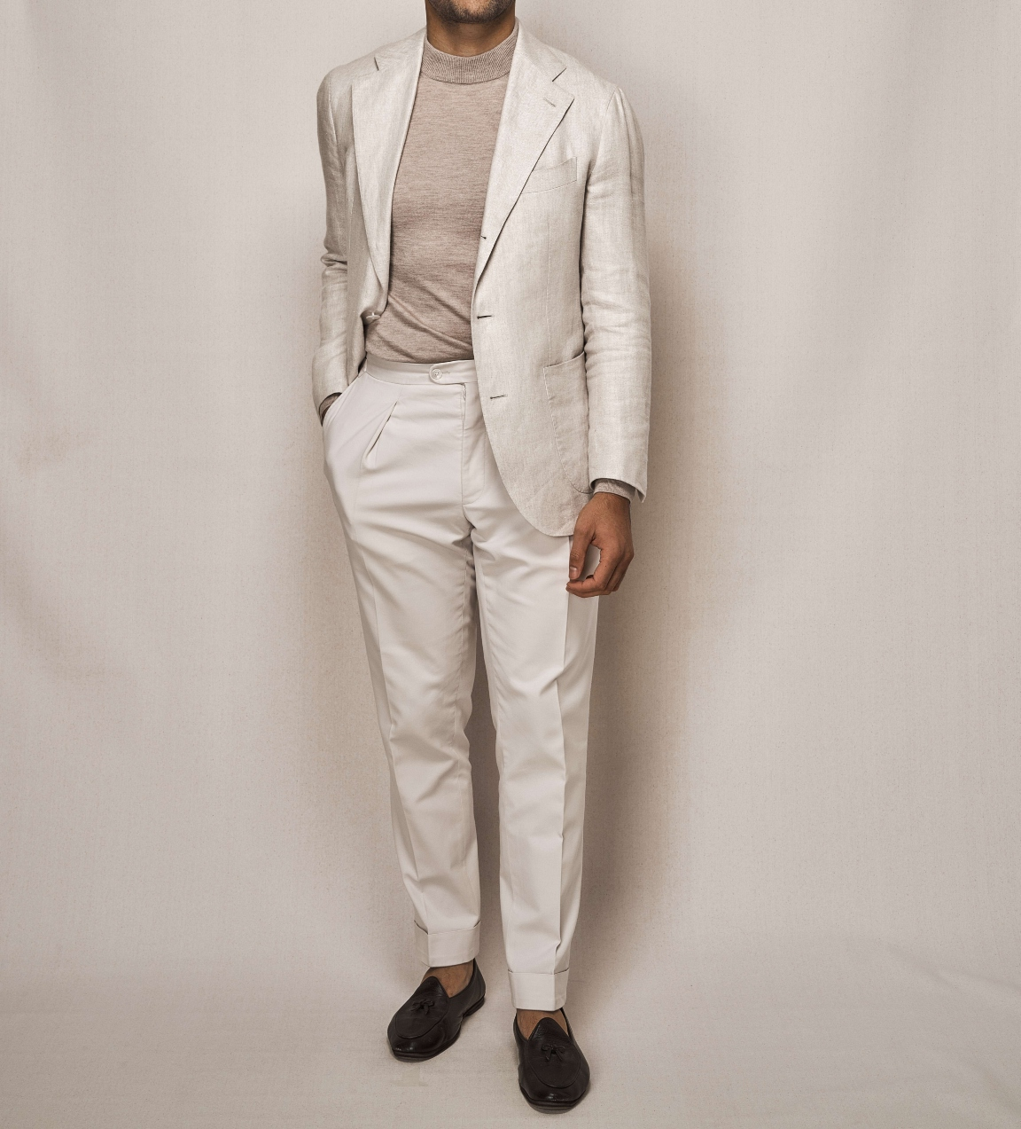 Man modelling a white linen day suit
