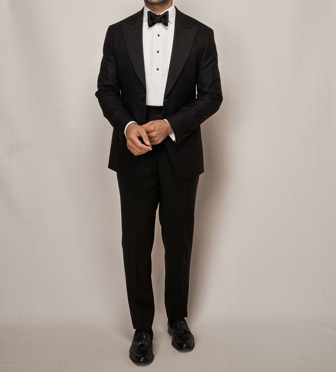 Man modelling a classic black tuxedo