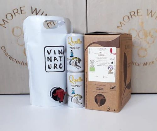 a pouch, box and cans of wine from the company More Wine