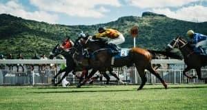Jockeys racing horses on racing tracks