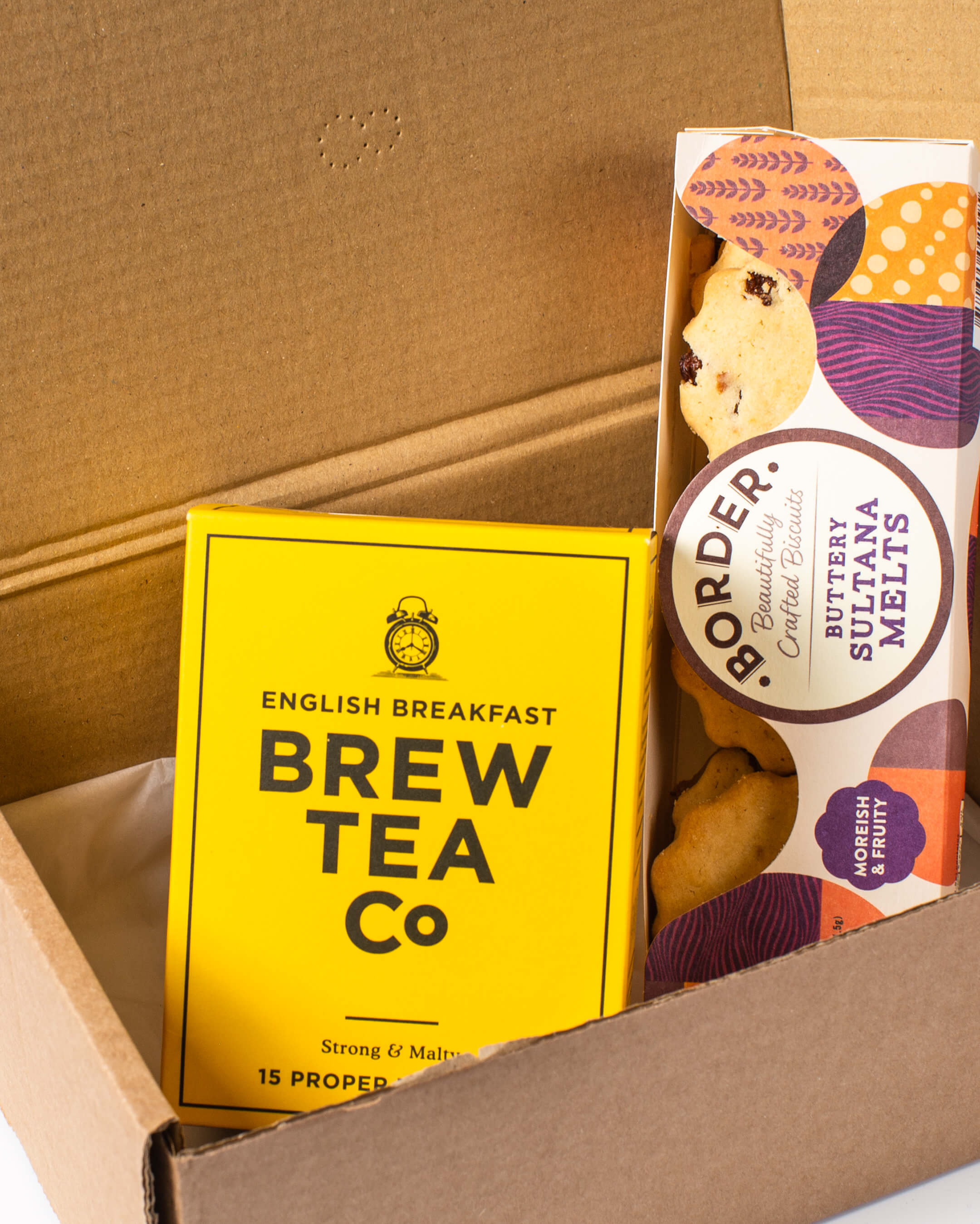 Inside the tea & biscuits box: Box of Brew tea Co. breakfast tea with Border biscuits