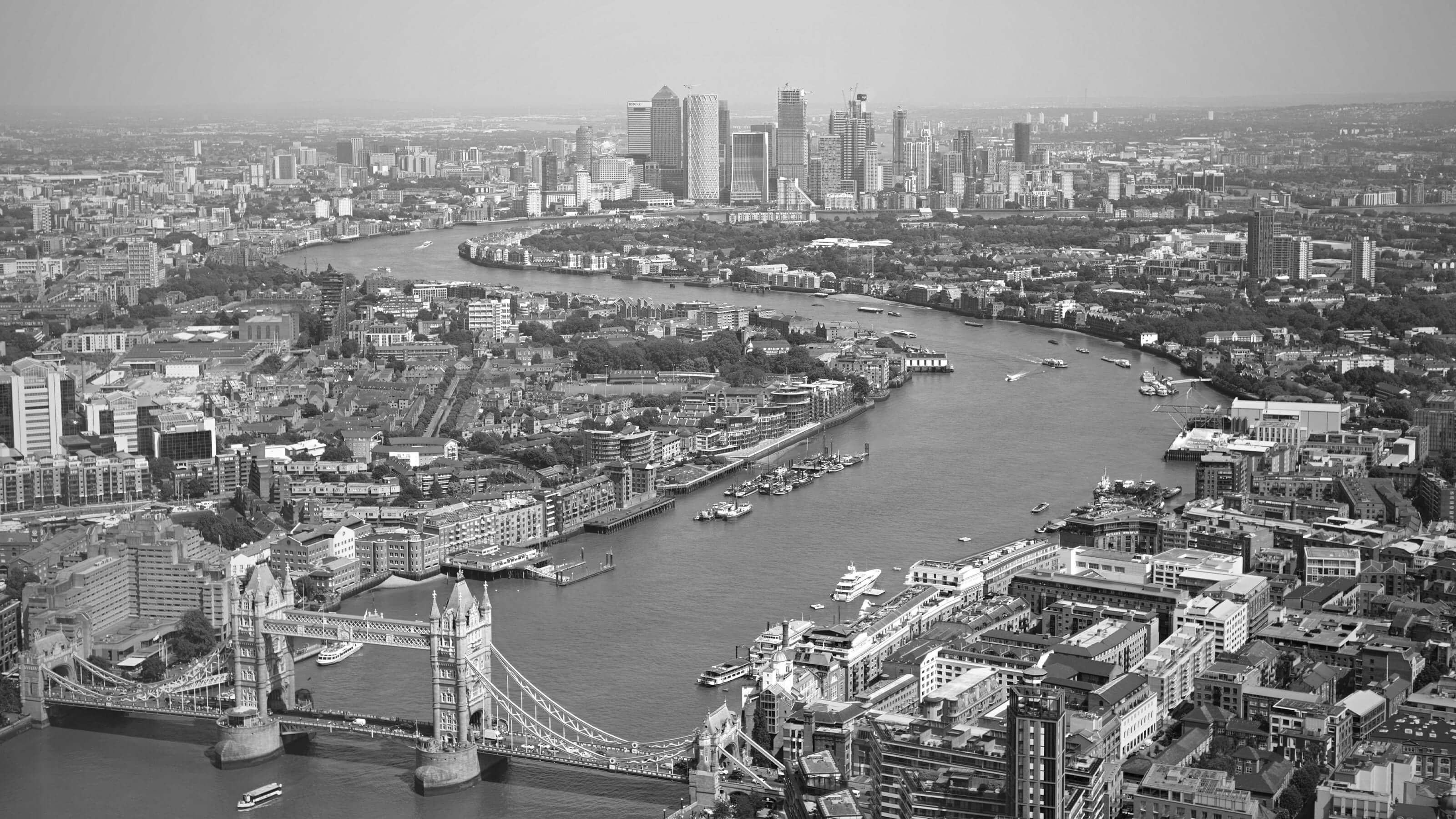 London skyline looking out over the thames. View shows Tower bridge and the city in the distance