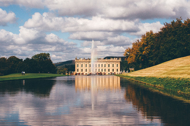 Lake and fountain looking onto Chatsworth House building