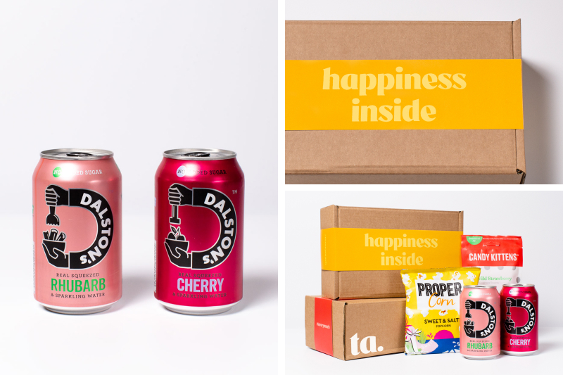 happiness inside box, with Dalston soft seltzer cans and Propercorn popcorn and Candy Kittens